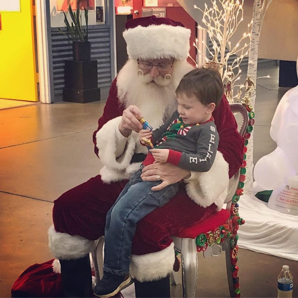 Santa Claus sitting with a young boy